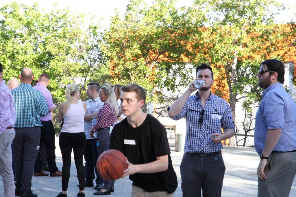 man making basketball shot on lunchbreak