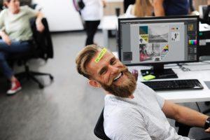 Man smiling at office desk