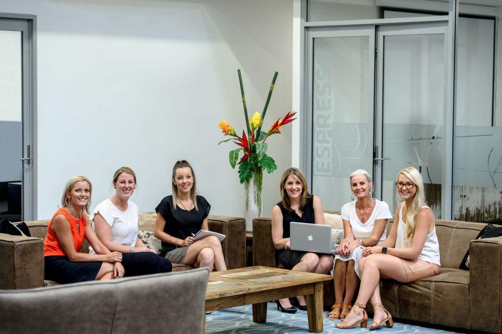 Team of women at work meeting.